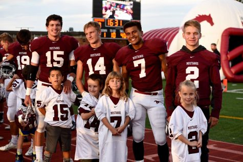 From left to right: Tyler Chavez, Kade Goertzen, De'Riece Burse, and Dawsen Counts, standing with their littles.