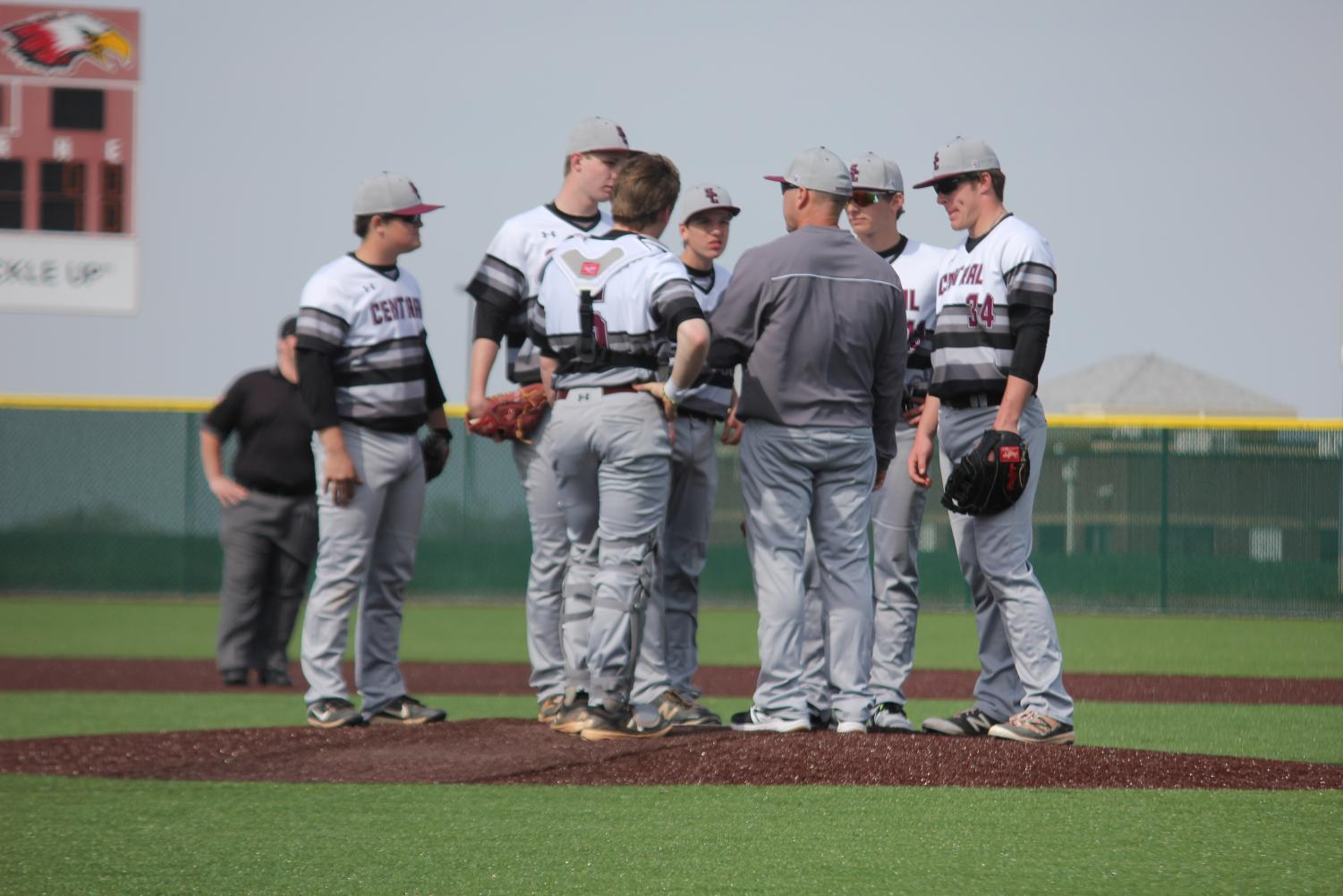 Infielders huddle around pitcher Ethan Speer