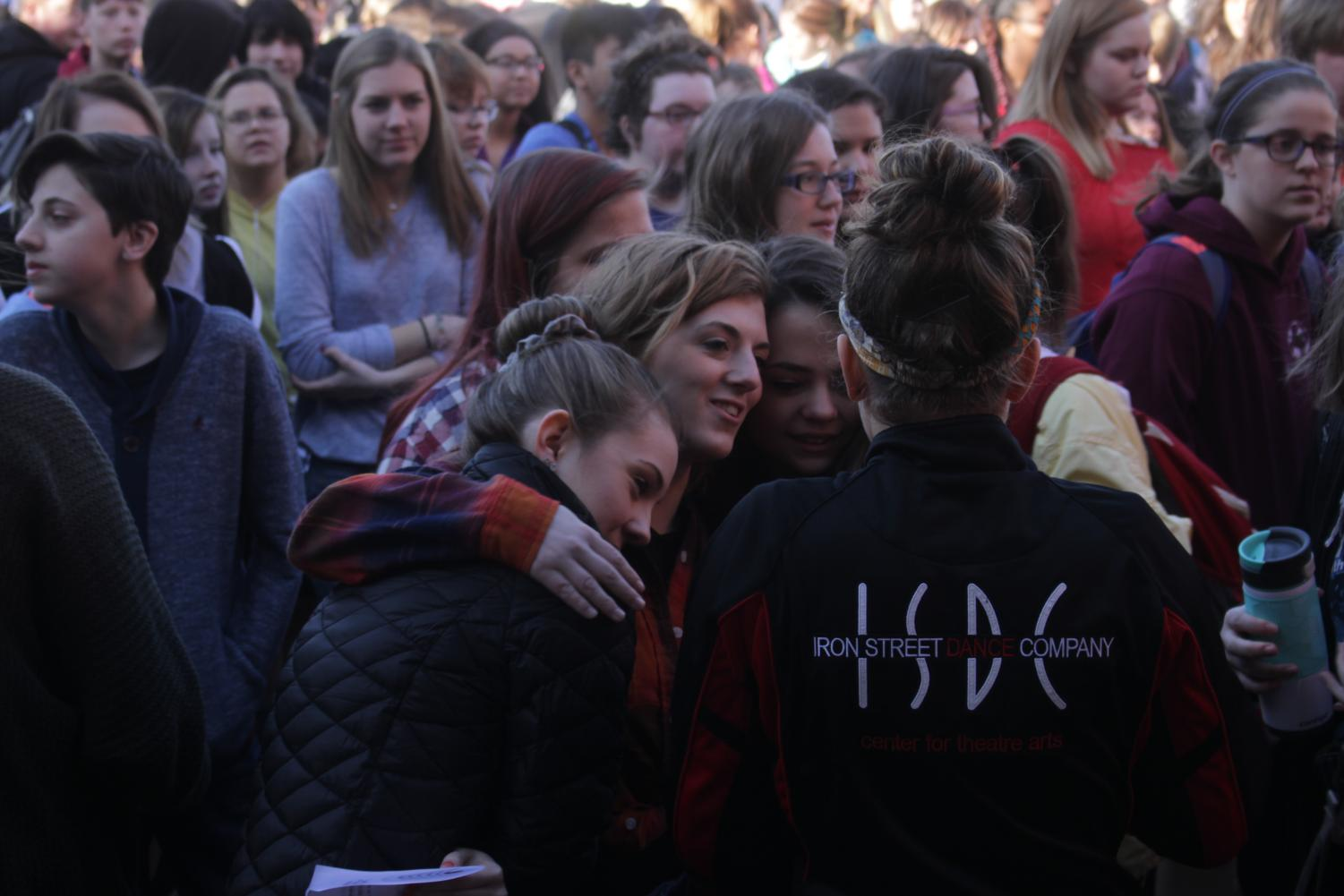 A group of students hug during the speeches and walkout on March 14.