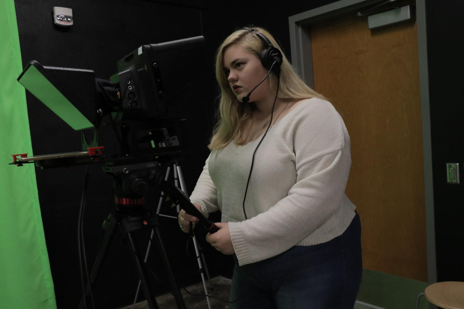 Senior Kerrigan Hutton behind the camera, helping produce the Mustang Media's broadcast.