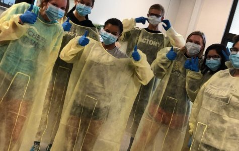 Students learn the proper way to put on CNA gowns, gloves and masks.