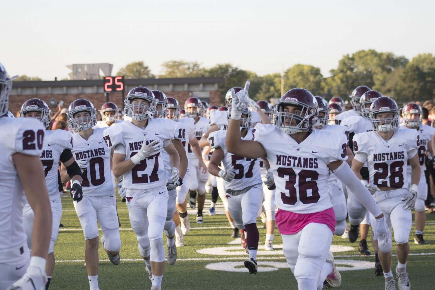 Mustangs running onto the field. Photo by Gavin Sutton